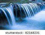 Blue Cascade Of Mountain River