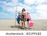 family at the beach - stock photo