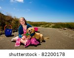 A young girl and her puppy outside - stock photo
