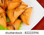 Meat roasted dumplings with lettuce on a plate - stock photo