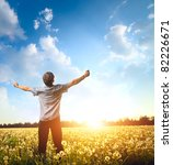 young man standing on a meadow... | Shutterstock . vector #82226671