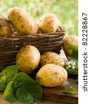 Basket of fresh tasty new potatoes. Selective focus - stock photo