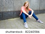 teenage girl sitting outdoors | Shutterstock . vector #82260586