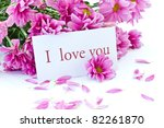 """says """"I love you"""" on a background of beautiful flowers - stock photo"""