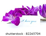 declaration of love against the backdrop of beautiful flowers - stock photo