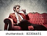 young man sitting on a sofa and ... | Shutterstock . vector #82306651