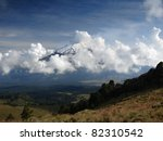 Volcano Popocatepetl from Iztaccihuatl, Mexico. - stock photo
