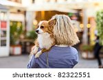 Stock photo  woman with chihuahua in old city 82322551