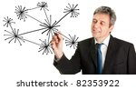 Businessman drawing a social network graph - stock photo