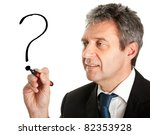 Businessman drawing a question mark - stock photo