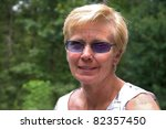 Older Woman with Sunglasses Outdoors - stock photo