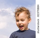 happy little boy on the sky background - stock photo