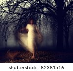 a woman in a very foggy forest | Shutterstock . vector #82381516
