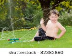 Young Boy Or Kid Cools Off By...