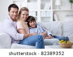 a happy family with a child at...   Shutterstock . vector #82389352