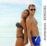 Beautiful smiling young couple having fun in the sea - stock photo