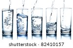 Five Water Glasses Being Fille...
