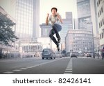 young happy man jumping on a... | Shutterstock . vector #82426141