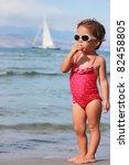 little girl with lollipop - stock photo
