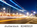 light trails on the street in beijing central business district,China - stock photo