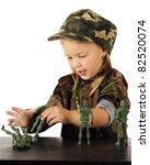 A Cute Preschooler In Army Gar...
