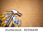 set of tools over a wood panel... | Shutterstock . vector #82546648