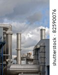 oil refinery with shinny metal tubes - stock photo