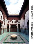 Meknes, Morocco: Interior courtyard with fountain of madrasah Muslim school in Meknes, Morocco. - stock photo