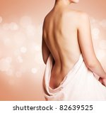 beautiful female back with towel | Shutterstock . vector #82639525