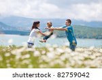 happy family having fun outdoors | Shutterstock . vector #82759042