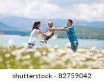happy family having fun outdoors | Shutterstock . vector #82759042