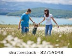 happy family having fun outdoors | Shutterstock . vector #82759048