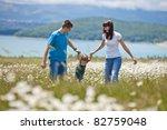 happy family having fun outdoors | Shutterstock . vector #82759048