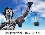 Justice Statue With Sword And...