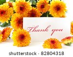 """""""thank you"""" on a background of orange chrysanthemums - stock photo"""