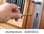 inserting a key into a house... | Shutterstock . vector #82832011