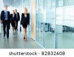 several businesspeople walking... | Shutterstock . vector #82832608