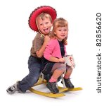 Two happy childs on a rocking horse. - stock photo