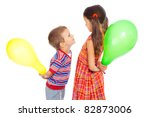Two smiling little children with color balloons, isolated on white - stock photo