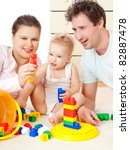 young  happy family in a room... | Shutterstock . vector #82887478