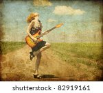 rock girl with guitar at... | Shutterstock . vector #82919161