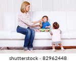 cute baby boy eating  his... | Shutterstock . vector #82962448