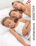 Siesta - woman and kids taking a nice summer afternoon nap - stock photo