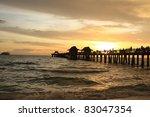 Sunset In Naples Pier On Beach...