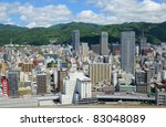 Skyline of Kobe, Japan nestled against Mount Rokko. - stock photo