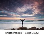 Woman Stands On Rocks In Front...
