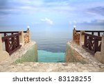 Entrance to Paradise: Steps leading into the Caribbean Sea, merging with the sky, at dusk. - stock photo