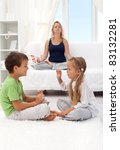Woman trying to relax with two quarreling child - focus on the boy, motion blur on the girl - stock photo