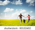 young happy couple running on a ... | Shutterstock . vector #83132602
