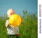 Little Boy Play In Green Grass